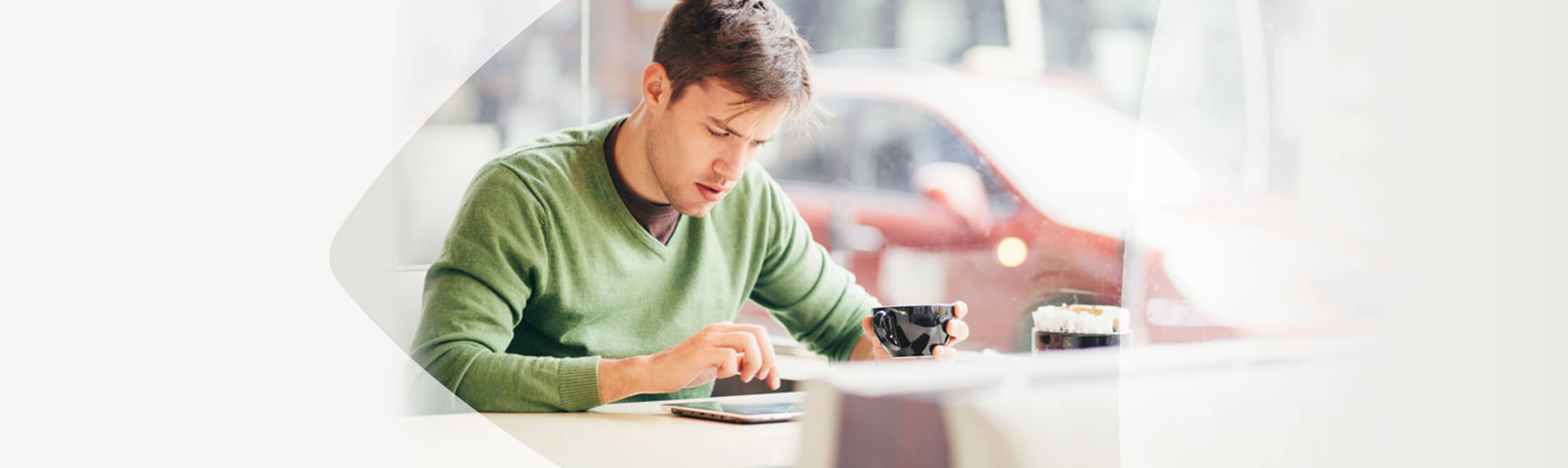 Man having a coffee while reading