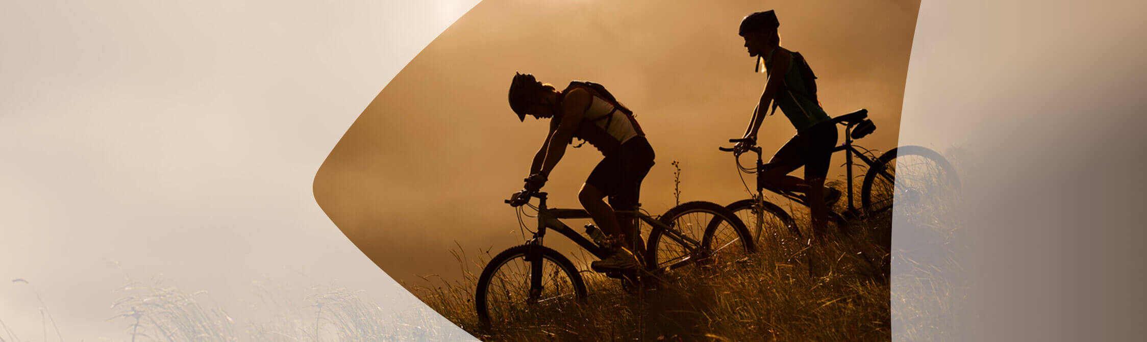 Couple biking downhill