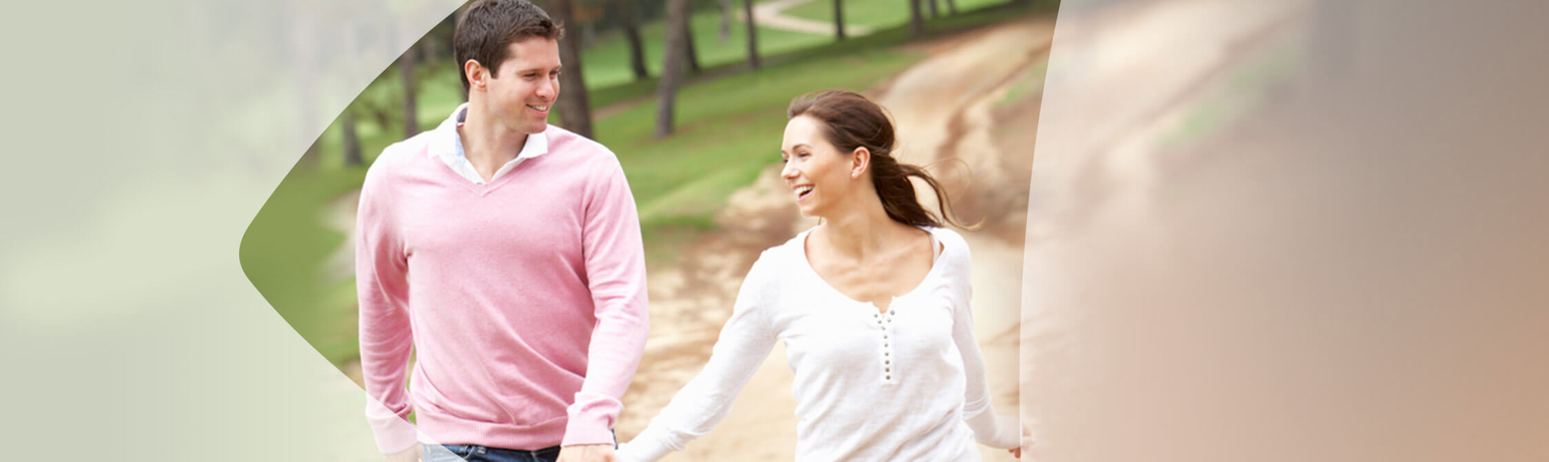 Couple walking together while holding hands and smiling