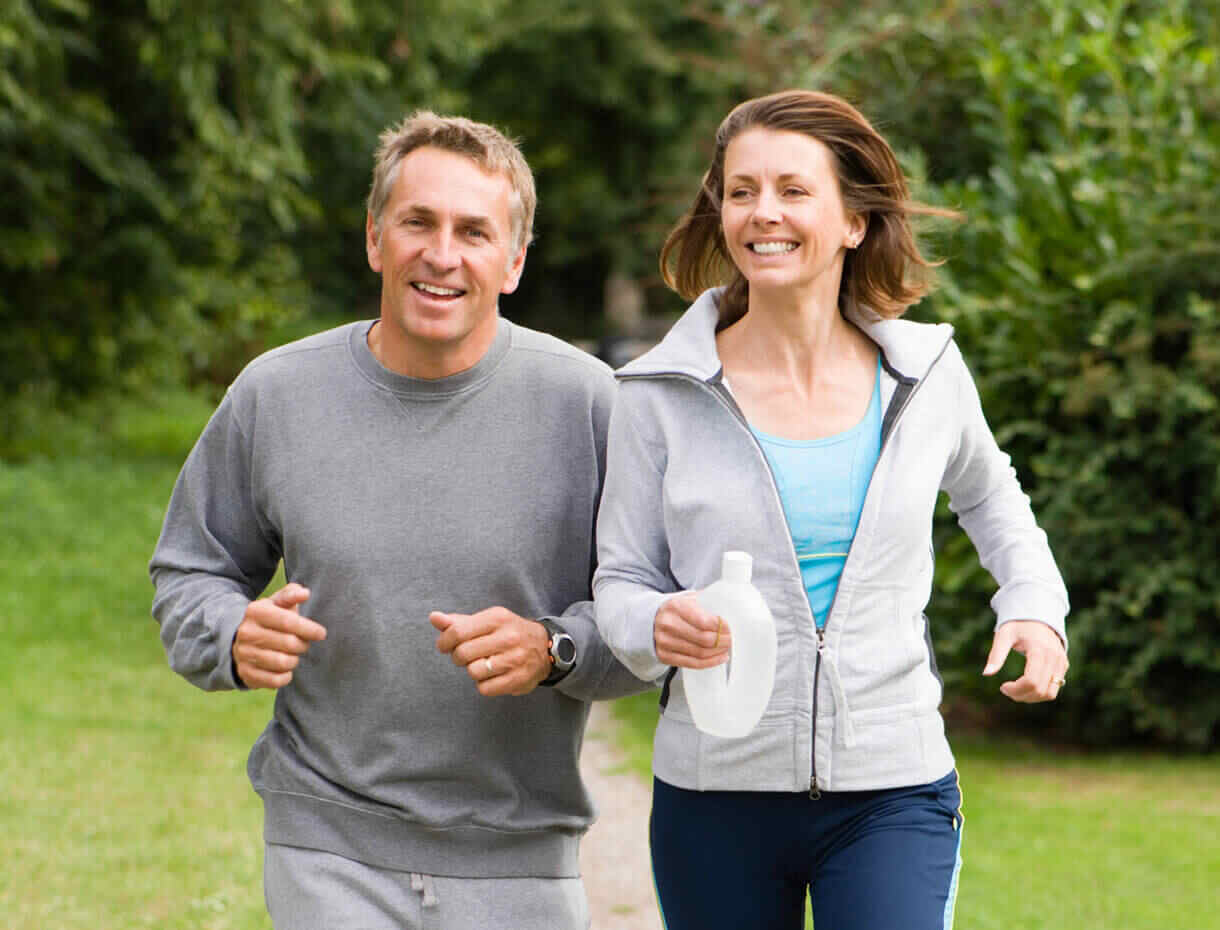 Couple Happily Jogging Together
